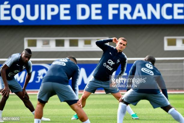 France's national football team forward Antoine Griezmann and teammates warm up during a training session at the team's training camp in...