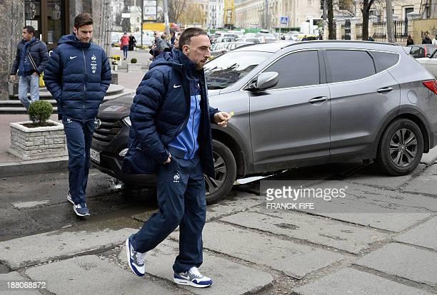 France's national football team forward Franck Ribery and France's forward Olivier Giroud walk in the streets of Kiev around their hotel on November...