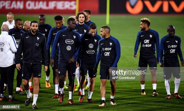 France's national football team forward imitri Payet defender Adil Rami and teammates attend a training session at the Vasil Levski stadium in Sofia...
