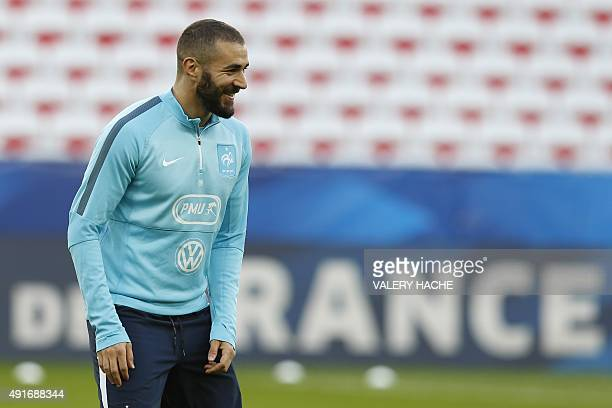France's national football team forward Karim Benzema attends a training session on the eve of the friendly football match France vs Armenia on...
