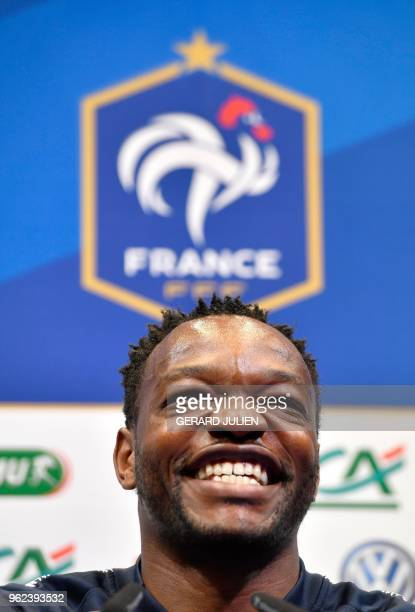 France's national football team goalkeeper Steve Mandanda smiles during a press conference at the team's training camp in Clairefontaine-en-Yvelines,...
