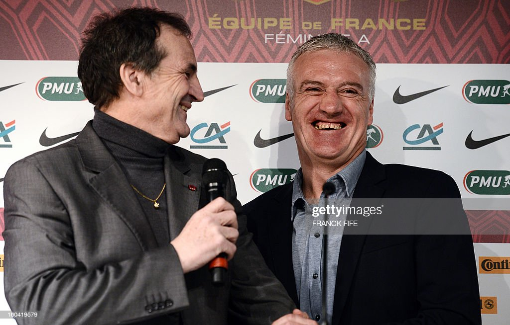 France's national football team head coach Didier Deschamps (R) and France's women national football team head coach Bruno Bini share a laugh as they give a press conference on January 31, 2013 to announce their squad for the friendly football matches against Germany next February 6, at the French Football Federation (FFF) headquarters in Paris.