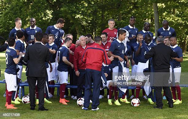 France's national football team midfielder Franck Ribery poses next to France's head coach Didier Deschamps before a team group photo at the French...