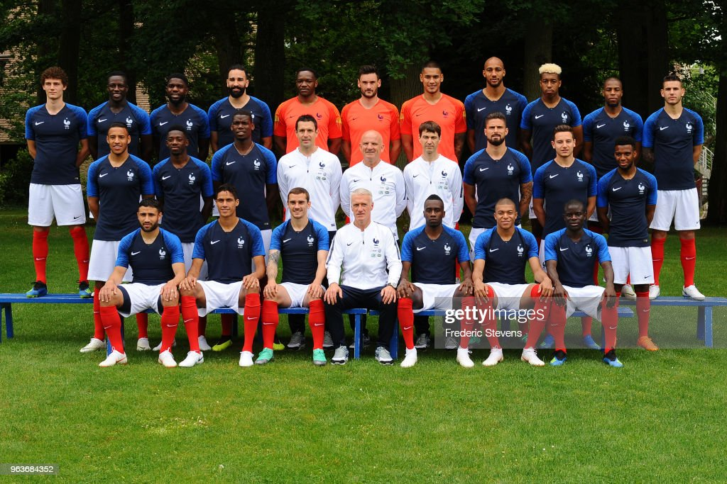 France's national football team players pose for a photo, back row (L-R) Benjamin Pavard, Benjamin Mendy, Samuel Umtiti, Adil Rami, Steve Mandanda, Hugo Lloris, Alphonse Areola, Steven Nzonzi, Presnel Kimpembe, Djibril Sidibe, Lucas Hernandez, middle row (L-R), Corentin Tolisso, Ousmane Dembele, Paul Pogba, goalkeeping coach Franck Ravio, assistant coach Guy Stephan, physical preparator Gregory Dupont, Olivier Giroud, Florian Thauvin, Thomas Lemar, front row (L-R) Nabil Fekir, Raphael Varane, Antoine Griezmann, head coach Didier Deschamps, Blaise Matuidi, Kylian Mbappe, N'golo Kante, during the official presentation at the French training center for the upcoming FIFA 2018 World Cup on May 30, 2018 in Clairefontaine, France.