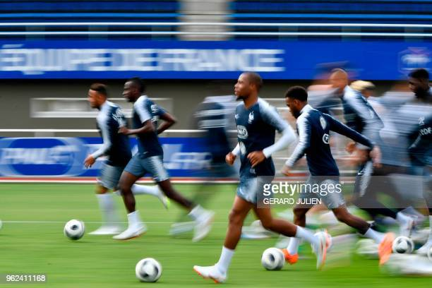 France's national football team players warm up during a training session at the team's training camp in ClairefontaineenYvelines near Paris on May...