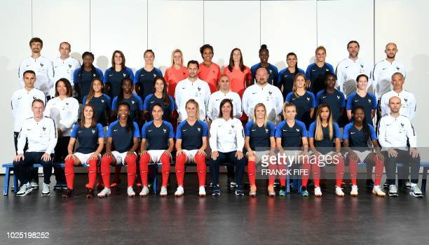France's national football team pose for an official picture on August 29 2018 in ClairefontaineenYvelines France's press officer Jérôme Millagou...