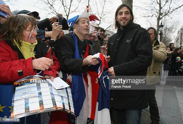 France's national handball team player Bertrand Gille signs autographs on Champs-Elysees on January 31, 2011 in Paris, France. France's handball wins...