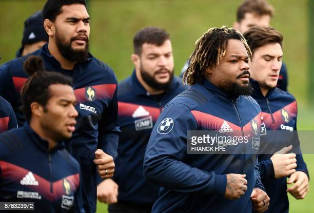 France's national rugby union team centre Mathieu Bastareaud warms up with team mates during a training session on the eve of a friendly rugby union...