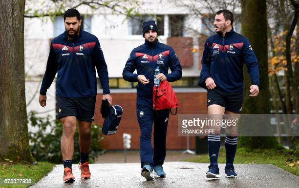 France's national rugby union team lock Romain Taofifenua full back Hugo Bonneval and N°8 Louis Picamoles arrive for a training session on the eve of...