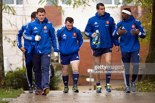 France's national rugby union team players arrive for a training session on November 21, 2013 in Marcoussis, south of Paris, ahead of the last rugby...