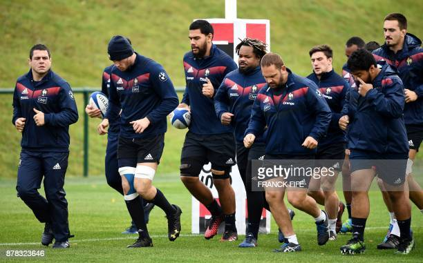 France's national rugby union team players warm up during a training session on the eve of a friendly rugby union international match between France...