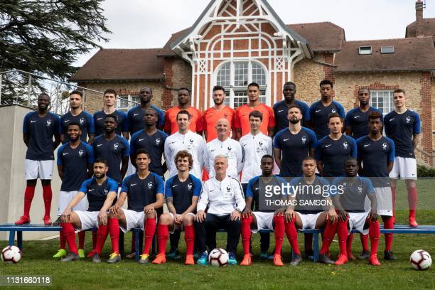 France's national team football players pose for a group photo at the teams' training ground in ClairefontaineenYvelines southwest of Paris on March...