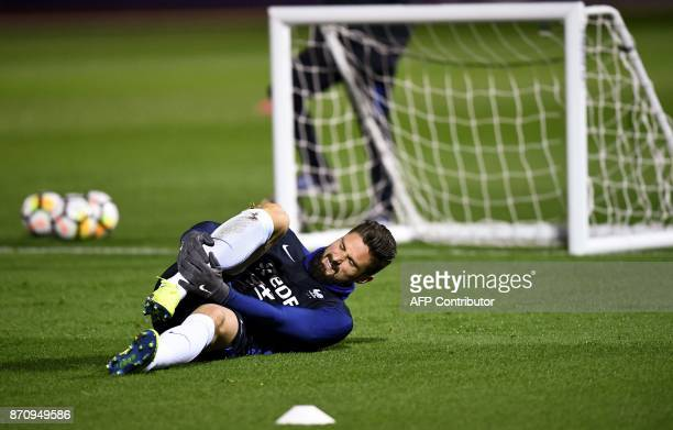 France's national team forward Olivier Giroud grimaces during a training session in ClairefontaineenYvelines near Paris on November 6 as part of the...