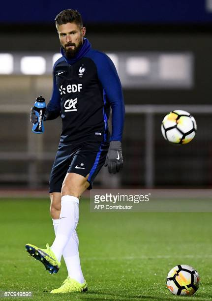 France's national team forward Olivier Giroud takes part in a training session in ClairefontaineenYvelines near Paris on November 6 as part of the...