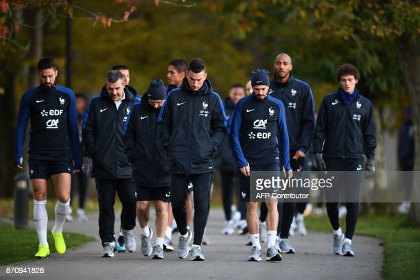 France's national team players arrive for a training session in Clairefontaine-en-Yvelines near Paris on November 6 as part of the team's preparation...