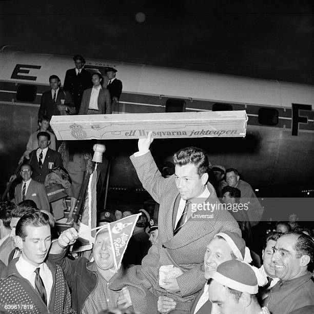 France's national team returns from Sweden after winning third place in the 1958 FIFA World Cup Just Fontaine is carried off with his trophy a gun...
