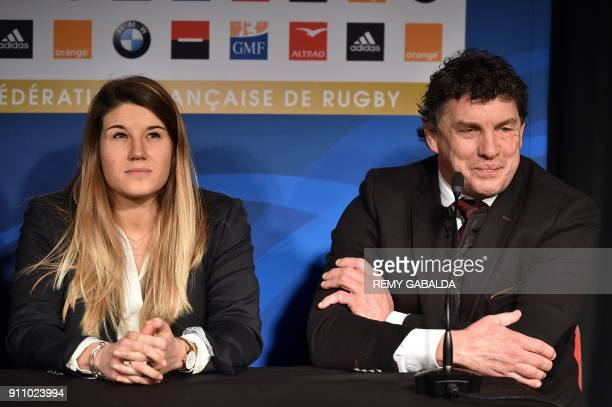 France's national women rugby team captain and flanker Gaelle Hermet and Toulouse's President Didier Lacroix speak during a press conference on...