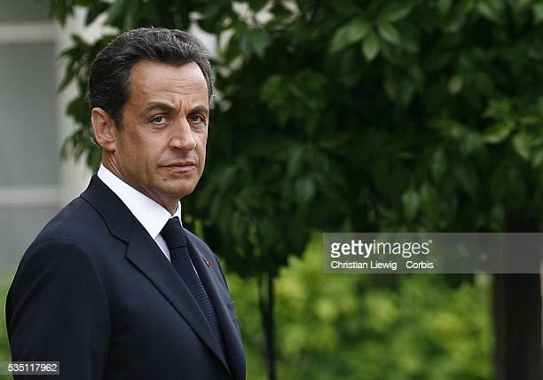 France's new President Nicolas Sarkozy attends an inaugural ceremony with Republican guards in the garden of the Elysee Palace in Paris after the...