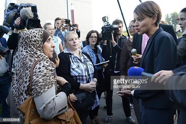 France's newly appointed Education Minister Najat VallaudBelkacem speaks with parents of pupils during a visit at the Denis Diderot elementary school...