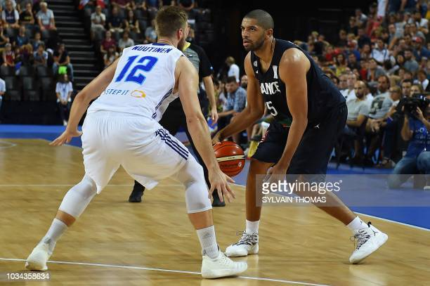 France's Nicolas Batum fights for the ball with Finland's Matti Nuutinen during the 2019 FIBA Basketball World Championship European qualifying group...