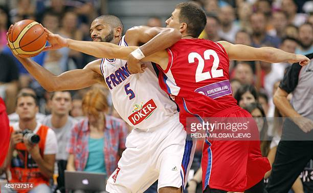 France's Nicolas Batum vies with Serbia's Nemanja Nedovic during a friendly basketball match between Serbia and France at the Kombank Arena in...