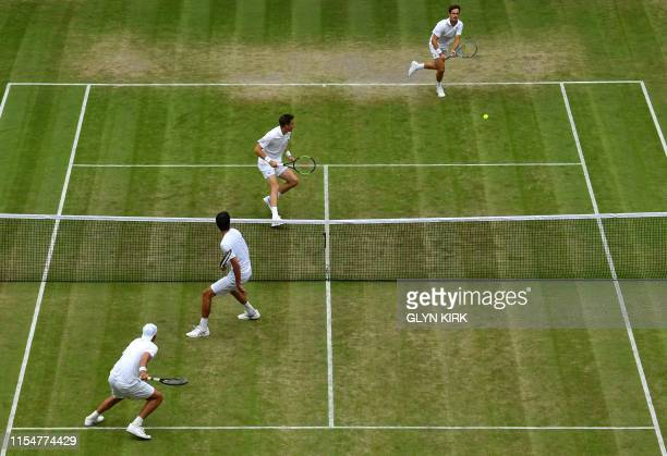 France's Nicolas Mahut and France's Edouard RogerVasselin play Poland's Lukasz Kubot and Brazil's Marcelo Melo during their men's doubles...