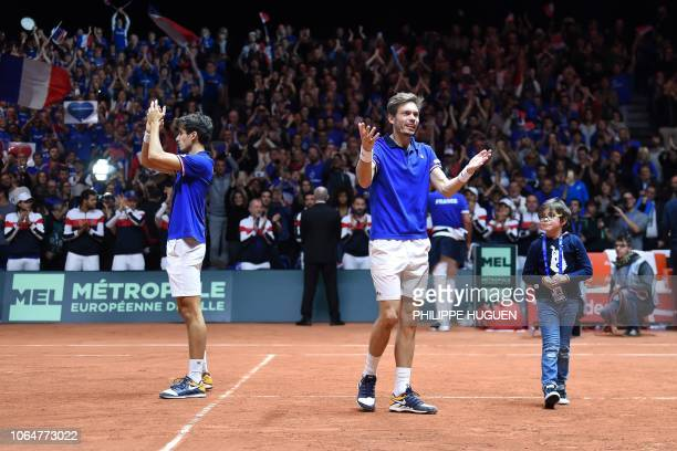 France's Nicolas Mahut and France's Pierre-Hugues Herbert celebrate winning against Croatia's Mate Pavic and Croatia's Ivan Dodig in their doubles...