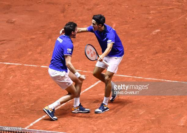 France's Nicolas Mahut and France's Pierre-Hugues Herbert celebrate winning against Croatia's Ivan Dodig and Croatia's Mate Pavic in their doubles...