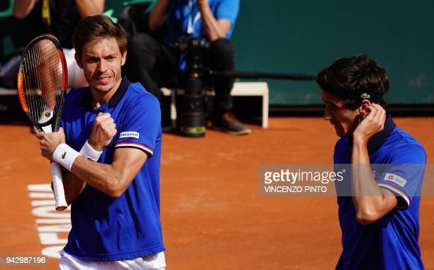 France's Nicolas Mahut and France's PierreHugues Herbert celebrate after winning the Davis Cup quarterfinal doubles tennis match against Italy's...