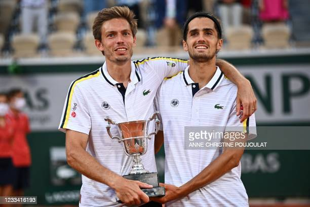 France's Nicolas Mahut and France's Pierre-Hugues Herbert celebrate with the Jacques-Brugnon Cup after winning their men's doubles final tennis match...