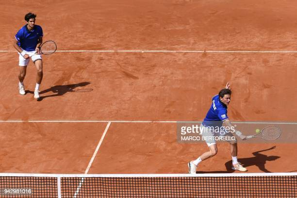 France's Nicolas Mahut and France's PierreHugues Herbert play against Italy's Fabio Fognini and Italy's Simone Bolelli during the Davis Cup...