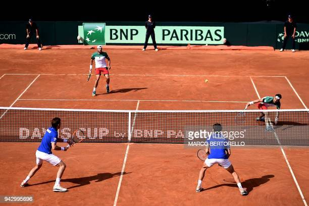 France's Nicolas Mahut and teammate France's PierreHugues Herbert play against Italy's Fabio Fognini and Italy's Simone Bolelli during the Davis Cup...