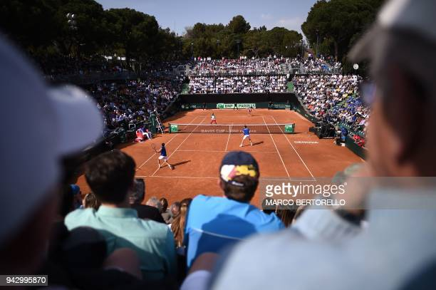 TOPSHOT France's Nicolas Mahut and teammate France's PierreHugues Herbert play against Italy's Fabio Fognini and Italy's Simone Bolelli during the...