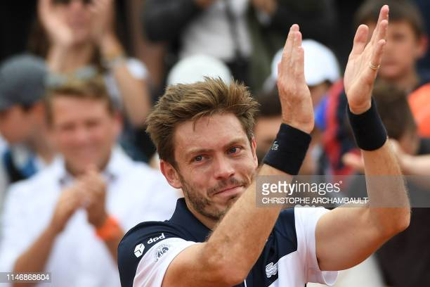 France's Nicolas Mahut celebrates after winning against Germany's Philipp Kohlschreiber during their men's singles second round match on day four of...