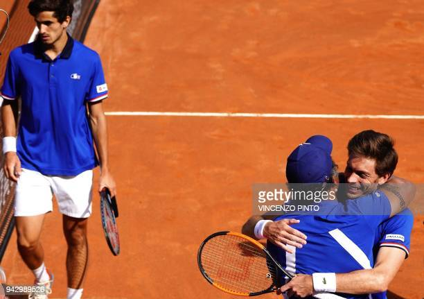 France's Nicolas Mahut celebrates with coach Yannick Noah next to France's PierreHugues Herbert after winning the Davis Cup quarterfinal doubles...