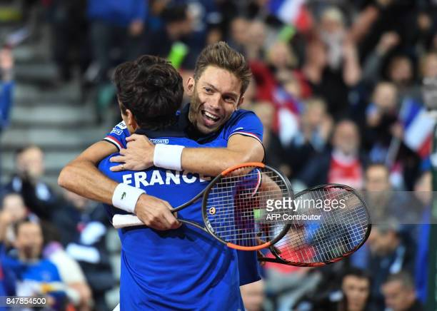 France's Nicolas Mahut celebrates with PierreHugues Herbert after winning their Davis Cup semifinal tennis match against Serbia at the Pierre Mauroy...