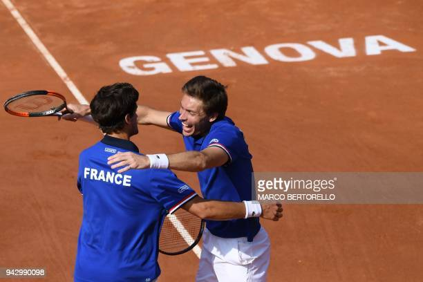 France's Nicolas Mahut celebrates with teammate France's PierreHugues Herbert after winning the Davis Cup quarterfinal doubles tennis match against...