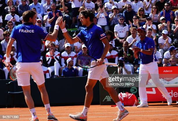 France's Nicolas Mahut compatriot France's PierreHugues Herbert and coach Yannick Noah celebrate a point against Italy's Fabio Fognini and Italy's...