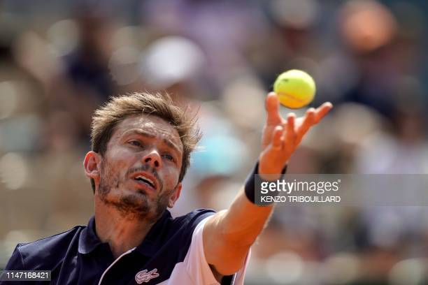 France's Nicolas Mahut eyes the ball as he serves to Argentina's Juan Ignacio Londero during their men's singles third round match on day six of The...
