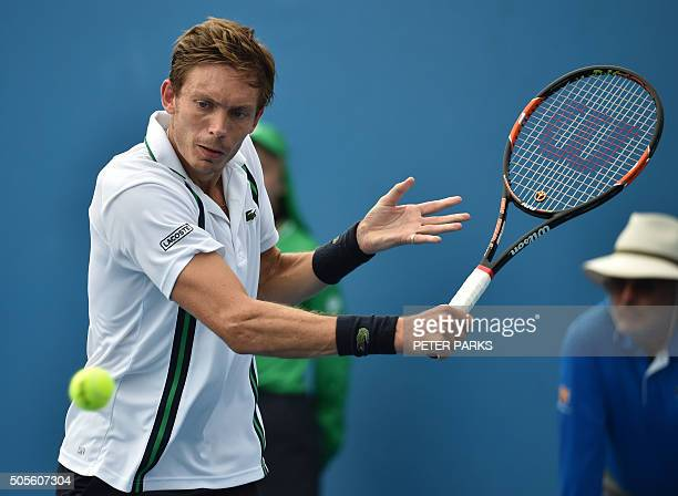France's Nicolas Mahut plays a backhand return during his men's singles match against Italy's Marco Cecchinato on day two of the 2016 Australian Open...