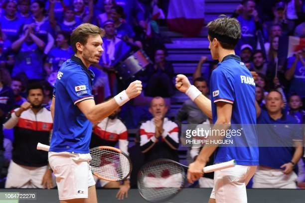 France's Nicolas Mahut reacts France's Pierre-Hugues Herbert as as they compete against Croatia's Mate Pavic and Croatia's Ivan Dodig during their...