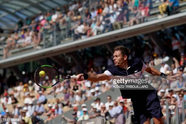 France's Nicolas Mahut returns the ball to Argentina's Juan Ignacio Londero during their men's singles third round match on day six of The Roland...