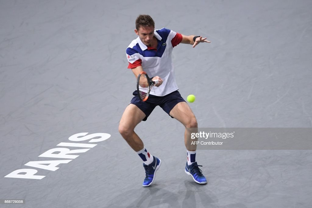 France's Nicolas Mahut returns the ball to Spain's Pablo Carreno Busta during their first round match at the ATP World Tour Masters 1000 indoor tennis tournament on October 31, 2017 in Paris. Mahut won the match 6-4, 6-1. /