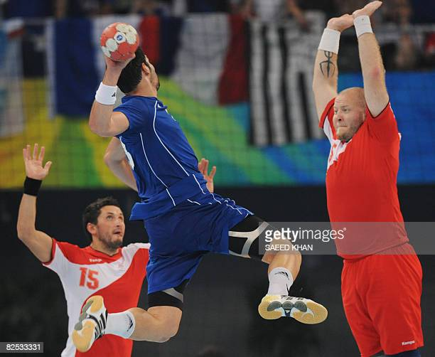 France's Nikola Karabatic aims at Iceland's goal during the men's handball gold medal match of the 2008 Beijing Olympic Games on August 24, 2008 in...