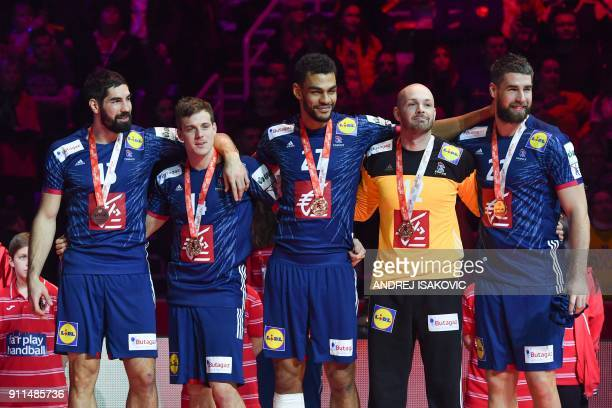 France's Nikola Karabatic France's Kentin Mahe France's Adrien Dipanda France's goalkeeper Vincent Gerard and France's Luka Karabatic pose with their...