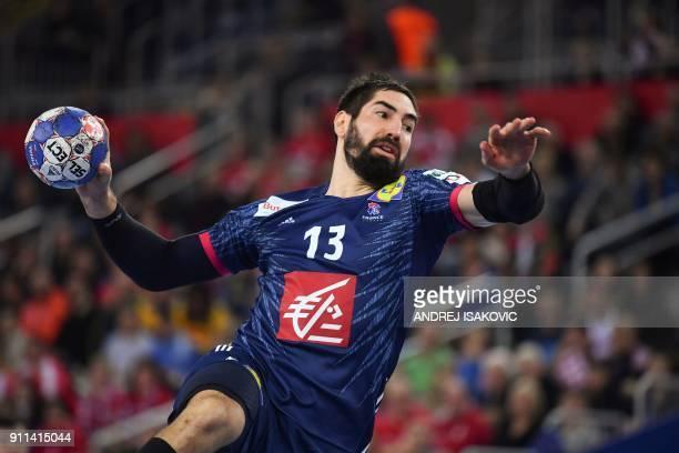 TOPSHOT France's Nikola Karabatic jumps to shoot on goal during the match for third place of the Men's 2018 EHF European Handball Championship...