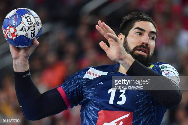France's Nikola Karabatic jumps to shoot on goal during the match for third place of the Men's 2018 EHF European Handball Championship between France...
