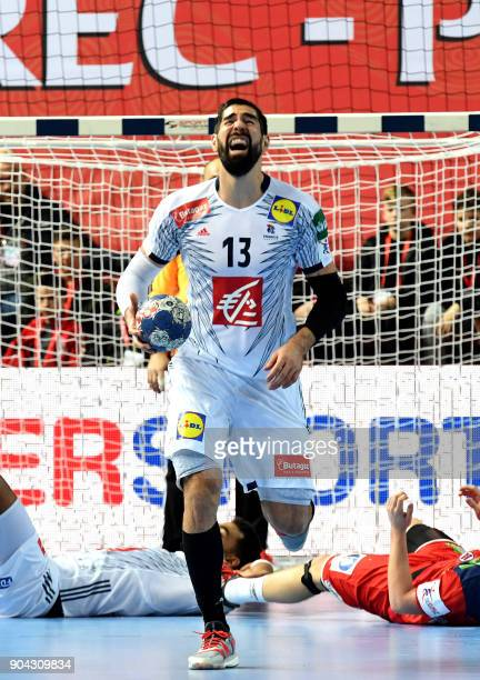 France's Nikola Karabatic reacts during the preliminary round Group B match of the Men's 2018 EHF European Handball Championship between France and...