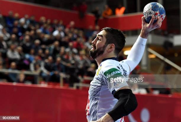France's Nikola Karabatic shoots on goal during the preliminary round group B match of the Men's 2018 EHF European Handball Championship between...