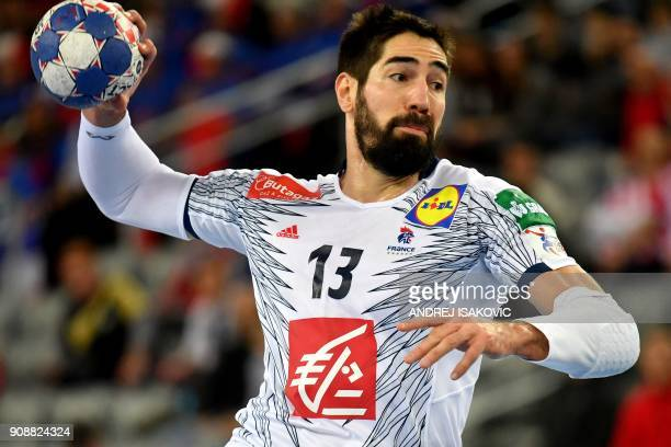 TOPSHOT France's Nikola Karabatic shoots the ball during the group I match of the Men's 2018 EHF European Handball Championship between Serbia and...